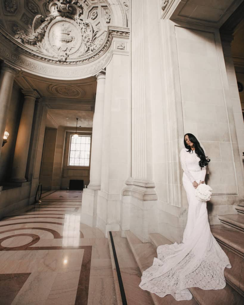 The bride standing at the Mayors Balcony