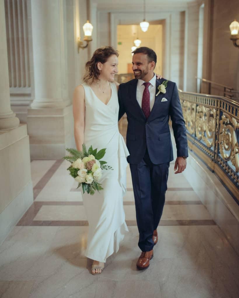 a couple walking at city hall hallway