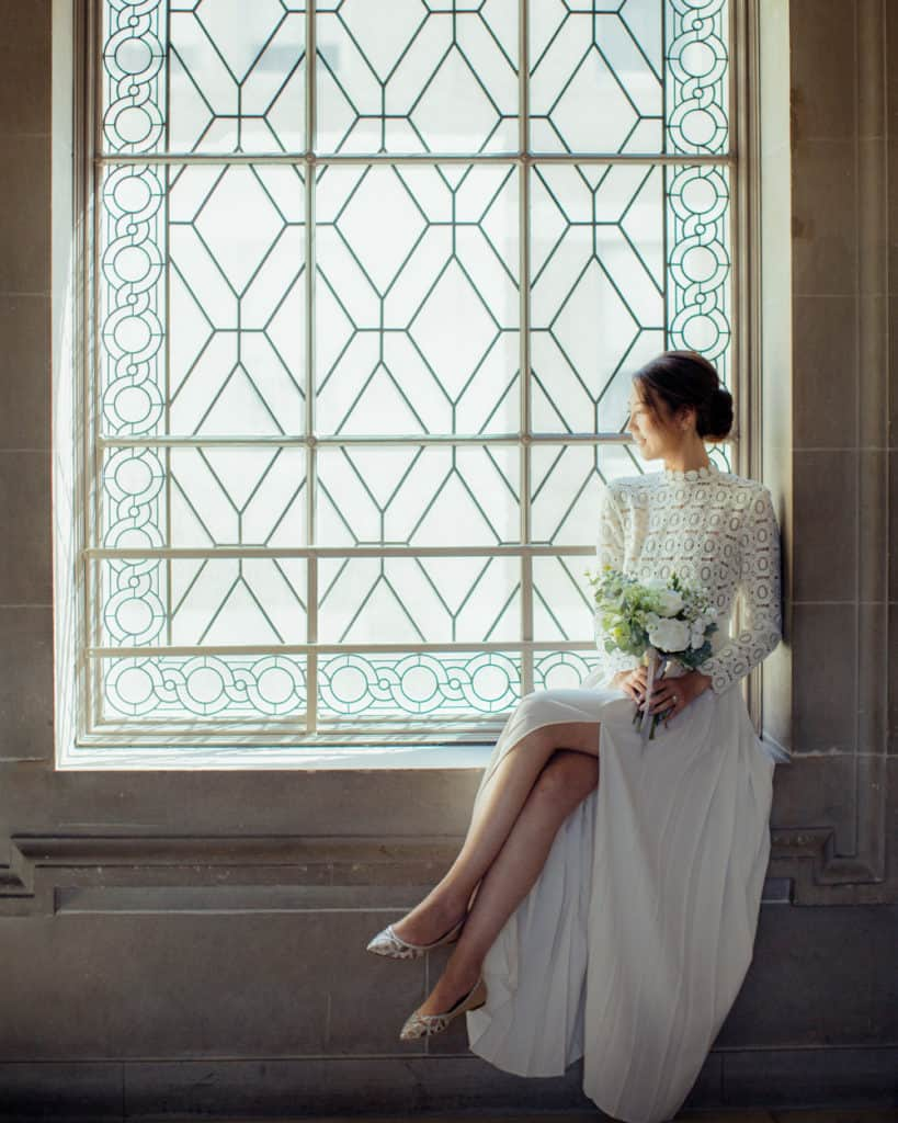 a bride sitting by the window on the 3rd floor
