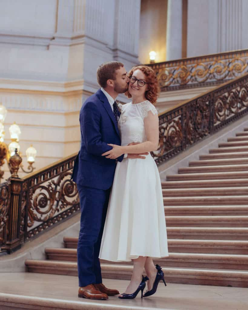 a couple kissing on the grand staircase