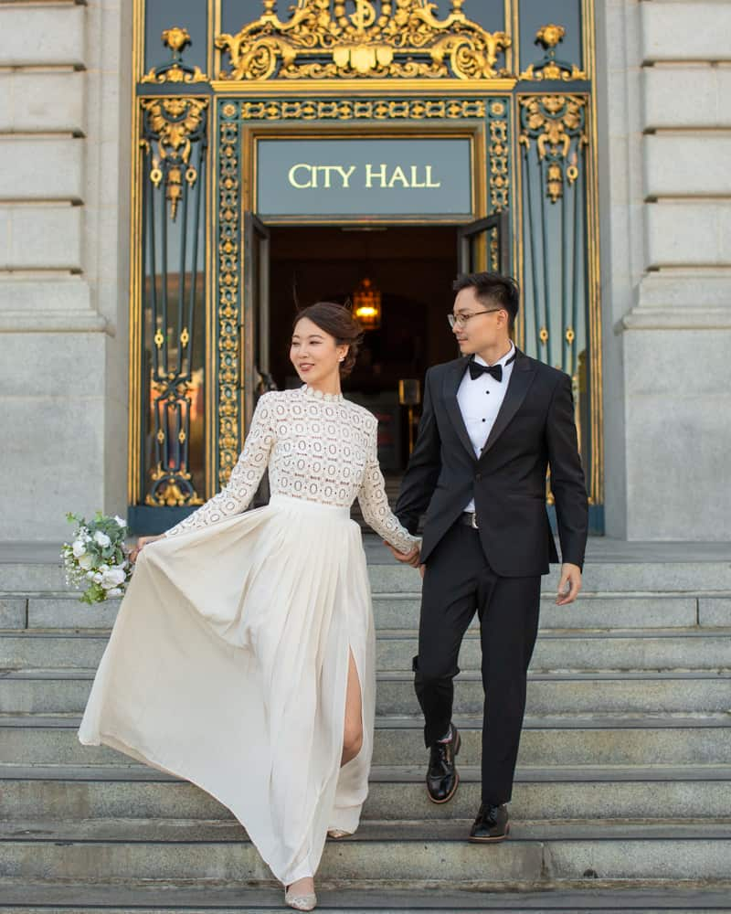 a couple walking down the entry stairs