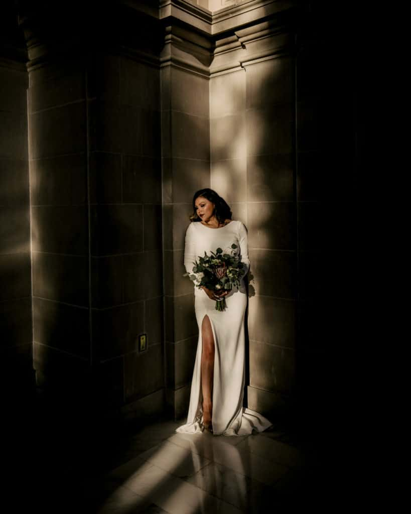 a bride standing at the sunlight on the 4th floor