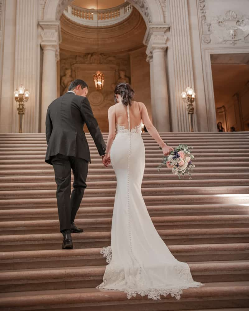 a couple walking up the grand staircase