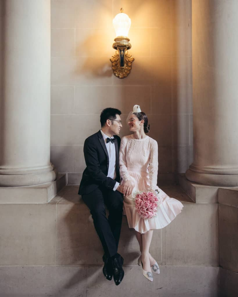 a bride in a pinkish dress with the groom near the rotunda