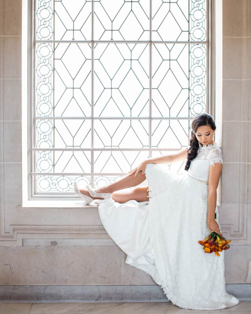 a bride holding the bouquet sitting